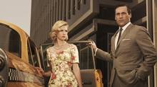 January Jones who plays Betty Draper and Jon Hamm who plays Don Draper on the hit television show Mad Men.