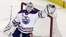 Edmonton Oilers goalie Cam Talbot stops a shot against the San Jose Sharks during Game 3 on Sunday. (Marcio Jose Sanchez/The Associated Press)
