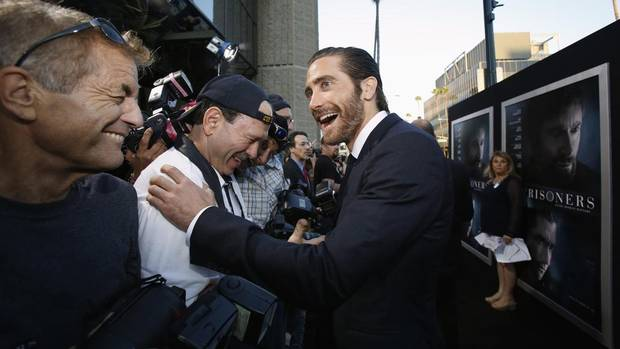 Holy cow is Jake Gyllenhaal excited that he finally got out of Toronto during the premiere of his film Prisoners at the Academy of Motion Picture Arts and Sciences in Beverly Hills, California September 12, 2013. (MARIO ANZUONI/REUTERS)