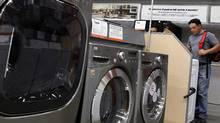 A shopper looks at washers and dryers at a Home Depot (SHANNON STAPLETON)