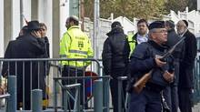 Police officers stand guard at the entrance of the Ozar Hatorah Jewish school in Toulouse, France, on March 20, 2012, a day after a gunman opened fire killing four people, including three children. (Remy de la Mauviniere/AP/Remy de la Mauviniere/AP)