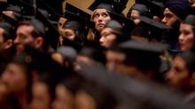 A University of British Columbia student looks up to the crowd while waiting to receive her diploma during a graduation ceremony at the university in Vancouver, B.C., on Thursday May 24, 2012. (DARRYL DYCK/THE CANADIAN PRESS)