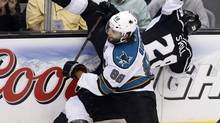 San Jose coach Todd McLellan says Brent Burns 'Isn't always following our system. It's frustrating at times, but he's a pretty good offensive player because he's reacting and reading and jumping here and making things happen.' The Sharks trail the Los Angeles Kings 2-0 in the best-of-seven series. (DANNY MOLOSHOK/REUTERS)