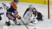 Edmonton Oilers' Ales Hemsky (C) scores a goal against Colorado Avalanche's goalie Semyon Varlamov (R) and Shane O'Brien during the second period of their NHL game in Edmonton February 16, 2013. (DAN RIEDLHUBER/REUTERS)