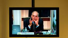 CRTC chairman Konrad von Finckenstein, is seen on a TV screen at the CRTC hearings in Gatineau, Que. (Sean Kilpatrick/The Canadian Press)