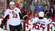 Ottawa Senators' Daniel Alfredsson (L) celebrates his goal with teammate Erik Karlsson during the second period of their NHL hockey game against the Calgary Flames in Calgary, Alberta, November 15, 2011. (TODD KOROL/REUTERS)