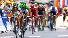 Mark Cavendish of Great Britain and Team Columbia - HTC sprints for the finish line on stage ten of the 2009 Tour de France from Limoges to Issoudun on July 14, 2009 in Issoudun, France. (Bryn Lennon/Getty Images)