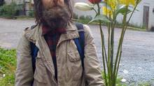 Tom Sawyer holds flowers in a circa 2008 handout photo. A new report released by a Vancouver-area street magazine says the life expectancy of a homeless person is about half that of the average British Columbian. (Paul Ruskay/THE CANADIAN PRESS)