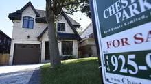 A realtor's sign sits on the lawn in front of a home for sale on Broadway Ave. in Toronto in this file photo. (Fred Lum/The Globe and Mail)