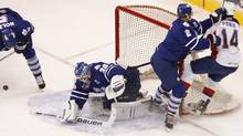 Toronto Marlies' Mark Fraser (2) puts a hit on Norfolk Admirals' Richard Panik during the first period of Game 2 of the AHL Calder Cup hockey finals, Saturday, June 2, 2012, in Norfolk, Va. Toronto's Korbinian Holzer, left, and goalie Ben Scrivens look for the puck. (Associated Press)