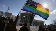 Anti-Proposition 8 protesters wave a rainbow flag in front of the U.S. Supreme Court in Washington, March 26, 2013. The Texas ban on same-sex marriage has been ruled unconstitutional. (JONATHAN ERNST/REUTERS)