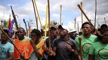 Mine workers gather at Wonderkop stadium outside the Lonmin mine in Rustenburg, northwest of Johannesburg. (SIPHIWE SIBEKO/REUTERS)