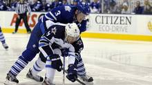 Toronto Maple Leafs defenceman Dion Phaneuf checks Winnipeg Jets forward Evander Kane in the first period. (Mike Cassese/Reuters/Mike Cassese/Reuters)