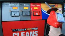 A customer holds a gas nozzle in Oakville, Ont., April 20, 2011. (Richard Buchan/The Canadian Press/Richard Buchan/The Canadian Press)