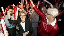 Ontario Premier Kathleen Wynne, left, and her partner Jane Rounthwaite, right, greet supporters and her caucus at a rally during the party's annual general meeting in Toronto on March 22, 2014. (NATHAN DENETTE/THE CANADIAN PRESS)