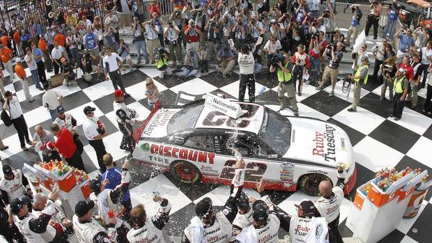 Kurt Busch celebrates in Victory Lane at Watkins Glen, New York in August 2011. (Tyler Barrick/Autostock)