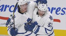 Toronto Maple Leafs' Tyler Bozak, left, celebrates with teammate Michael Kostka after scoring against the Montreal Canadiens during second period NHL hockey action in Montreal, Saturday, January 19, 2013. The Leafs won 2-1. (Graham Hughes/THE CANADIAN PRESS)