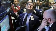 Traders at the New York Stock Exchange. Forecaster and money manager Gary Shilling says investors should remain on deflation alert, believing that the U.S. Fed is only delaying falling consumer price levels through its latest effort at money creation. (Richard Drew/AP)