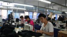 Workers at Wenzhou Sinoman Clothing. (Yu Mei/Yu Mei/For The Globe and Mail)