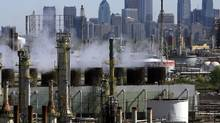 The Sunoco Philadelphia Refinery, a plant which is part of Sunoco's refining and supply business that manufactures gasoline, diesel, jet fuel and other petrochemicals, is backdropped by the Philadelphia skyline Friday April 28, 2006. (MATT ROURKE/MATT ROURKE/AP)