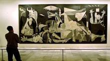 Picasso's painting Guernica, above, depicts the horror of a bombing raid on a small Spanish town by fascists. (Denis Doyle/The Associated Press)