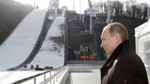 Russia's President Vladimir Putin visits the RusSki Gorki Jumping Center at the Krasnaya Polyana resort near the Black Sea city of Sochi, Feb. 6, 2013. The complex is expected to host ski jumping and Nordic combined competitions during the Sochi 2014 Winter Olympic Games, according to organizers. (SERGEI KARPUKHIN/REUTERS)