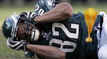 This is an Oct. 26, 2009, file photo showing Philadelphia Eagles tight end L.J. Smith holding his head after a hard hit by Atlanta Falcons' Lawyer Milloy during the fourth quarter of a football game in Philadelphia. Smith suffered a concussion and Milloy was flagged for an unnecessary roughness penalty on the play. In dozens of interviews across the NFL this week, The Associated Press found players voicing nearly unanimous support for changes in league policies on concussions. (AP Photo/Mel Evans, File) (Mel Evans)