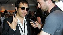 Atom Egoyan speaks to a journalist at the Canada Pavillion, May 18, 2010, in Cannes, France. (Andreas Rentz/Getty Images/Andreas Rentz/Getty Images)