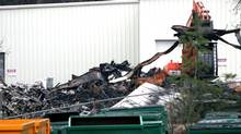 Work crews remove the still-smouldering rubble from a fire at a recycling plant near Trail, B.C. (Trevor Kehoe/Trevor Kehoe)