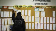 A young adult searches a job board at YES Youth Employment Services in Toronto in 2009. (Kevin Van Paassen/The Globe and Mail)