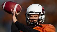 B.C. Lions' quarterback Travis Lulay passes during football practice in Surrey, B.C., on Tuesday November 15, 2011. The B.C. Lions and Edmonton Eskimos will play in the CFL's Western Final Sunday in Vancouver. (DARRYL DYCK/THE CANADIAN PRESS)