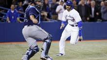 Toronto Blue Jays pinch runner Kevin Pillar (11) scores on a throwing error as Tampa Bay Rays catcher Roman Ali Solis (43) tries to make a play in the ninth inning at Rogers Centre. (John E. Sokolowski/USA Today Sports)