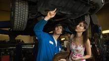 Mechanic and customer in garage. (PHOTOS.COM)