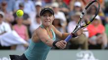 Eugenie Bouchard, of Canada, returns a volley against Peng Shuai, of China, during a second-round match at the BNP Paribas Open tennis tournament on Friday, March 7, 2014, in Indian Wells, Calif. ( (Associated Press)
