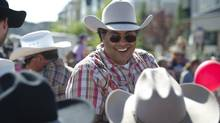 Calgary mayor Naheed Nenshi greets supporters at a Stampede breakfast on July 10, 2013. (Kevin Van Paassen/The Globe and Mail)
