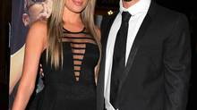 Oscar Pistorius (R) and his girlfriend Reeva Steenkamp pose for a picture in Johannesburg in this February 7, 2013 file photograph. (STRINGER/REUTERS)