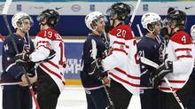 Canada's players shake hands with players of theU.S.following their semi-final game at the 2013 IIHF U20 World Junior Hockey Championship inUfaJanuary 3, 2013. (Reuters)