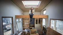 Samantha Gambling sits in her in-construction 220-square-foot tiny house – 10 by 22 feet – in Vancouver on Sunday. (Ben Nelms/The Globe and Mail)