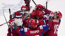 Russia celebrates after defeating Team USA (Nathan Denette/THE CANADIAN PRESS)
