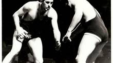 Alexis Nihon, left, took up wrestling as a youth, a sport his father had enjoyed in his native Belgium.