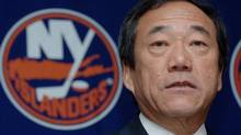 FILE - In this Jan. 12, 2006, file photo, New York Islanders' owner Charles Wang speaks during a news conference in Uniondale, New York. The Islanders have announced that the team is being sold to a former Washington Capitals co-owner and a London-based investor. (HENNY RAY ABRAMS/AP)