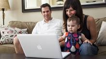 Left to right: Jason Campbell, Christina Campbell and 17-month-old Ava Campbell in Toronto use Skype to keep in touch with family on July 24, 2009. (Della Rollins for The Globe and Mail/Della Rollins for The Globe and Mail)