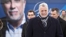 Quebec Liberal Party Leader Philippe Couillard walks to a news conference Wednesday, March 19, 2014 in Quebec City (Jacques Boissino/THE CANADIAN PRES)