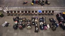 Row upon row of baggage sits in the baggage claim area at Toronto Pearson International Airport's Terminal 1 on Jan. 8 2014. (Fred Lum/Fred Lum/The Globe and Mail)