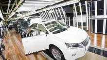 Lexus vehicles being built on the line at the Lexus plant in Cambridge, Ont., on June 18, 2014. (Peter Power For The Globe and Mail)