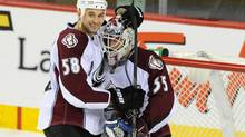 Colorado Avalanche left wing Patrick Bordeleau (58) and goalie Jean-Sebastien Giguere (35) celebrate their 3-2 win against the Calgary Flames at Scotiabank Saddledome. (CANDICE WARD/USA TODAY SPORTS)