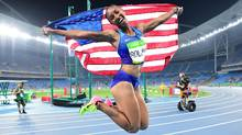 This file photo taken on August 17, 2016, shows USA's Brianna Rollins celebrating the gold medal in the Women's 100m Hurdles Final during the athletics event at the Rio 2016 Olympic Games at the Olympic Stadium in Rio de Janeiro. (FRANCK FIFE/AFP/Getty Images)