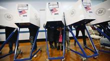 ,Cassaiya Oligario, waits as her mother Cassandra and older sister Eleahna vote in the U.S. presidential election at a displaced polling center in the Coney Island section of Brooklyn, New York November 6, 2012. (BRENDAN MCDERMID/REUTERS)