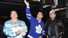 Nishnawbe Aski Nation Grand Chief Alvin Fiddler, centre, acknowledges the crowd, along with the NHL's first indigenous hockey player, Fred Sasakamoose, right, and Chief of the Mississaugas of the New Credit First Nation, Stacey LaForme, during the first intermission of an NHL game between the Toronto Maple Leafs and Edmonton Oilers in Toronto on Nov. 1, 2016. (Nathan Denette/The Canadian Press)