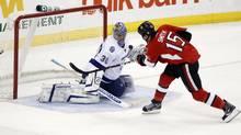 Ottawa Senators' Zach Smith scores on Tampa Bay Lightning goalie Dwayne Roloson during the third period in Ottawa Dec. 5, 2011. (Blair Gable/Reuters/Blair Gable/Reuters)